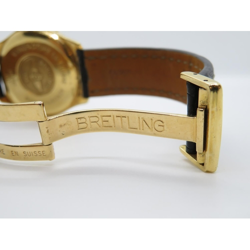 50 - Breitling 18ct Aerospace watch with original strap and 18ct folding lock - requires batteries