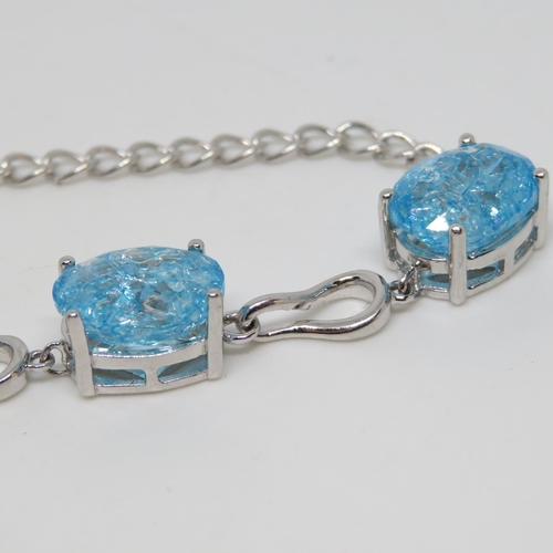 54 - Ladies silver bracelet set with crazed blue topaz 7.5
