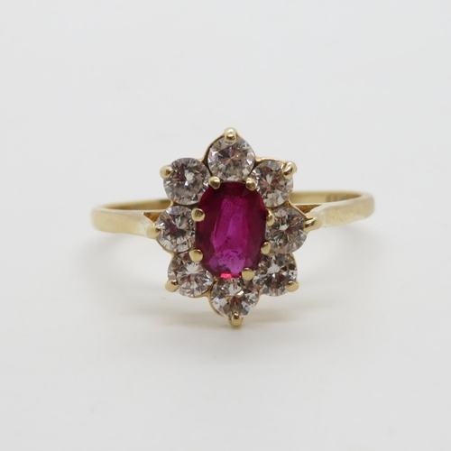 296 - Ruby and 8 diamond cluster ring 2.5g Size q  Marked 375 but tests at 14ct