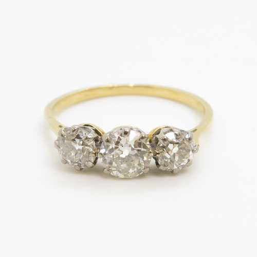 324 - 18ct gold with old cut diamonds trilogy ring - three diamonds add up to total of 1.5cts. Size T 2.5g