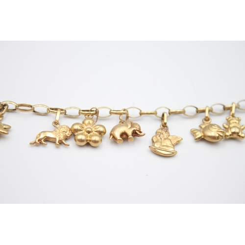 20 - vintage 9ct gold rolo link charm bracelet with a variety of charms 5.7g