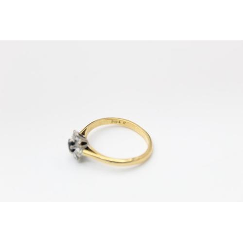 44 - 18ct gold sapphire & diamond halo ring 3.3g Size L