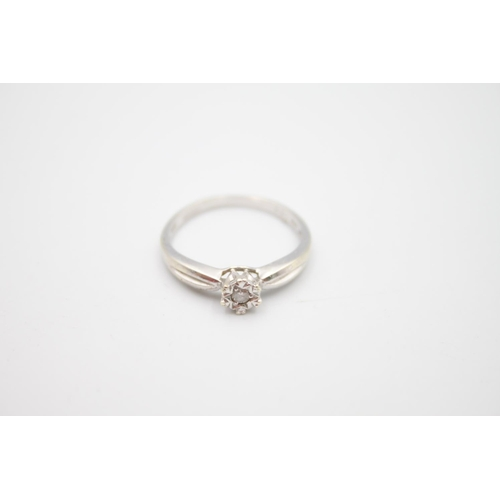 58 - 2 x 9ct white gold diamond rings inc bypass, solitaire 3.6g Size K on left & N on right