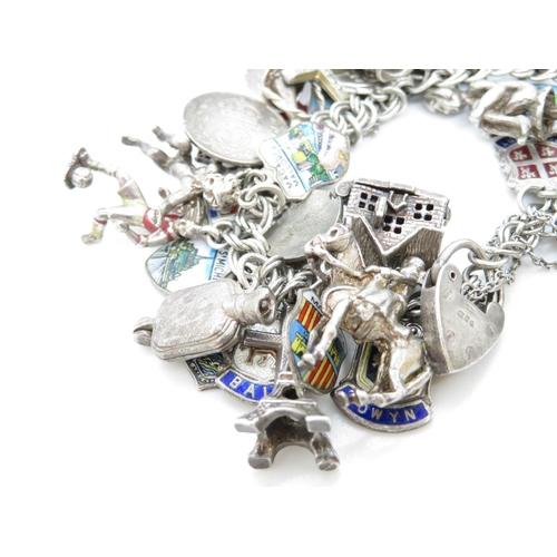 18 - Silver charm bracelet 96g