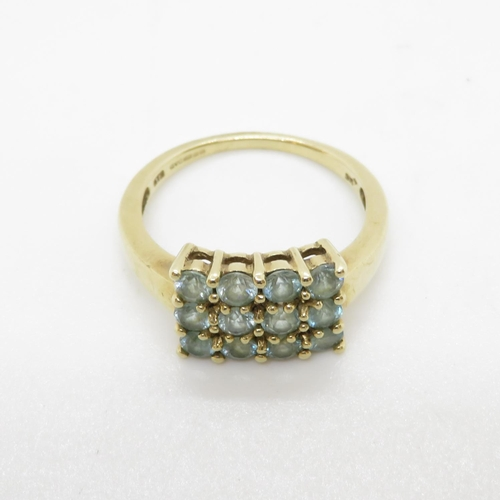 14 - 9ct gold ring light blue stones 3.7g size P