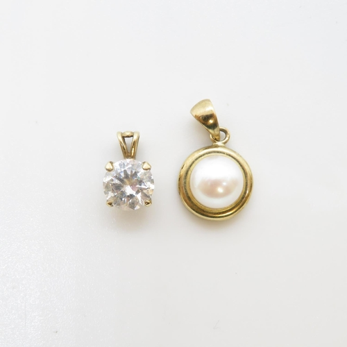 43 - Pair of 9ct pendants one with pearl and one with CZ  2.5g