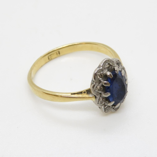 6 - 18ct ring with diamonds and blue stone 3g size N