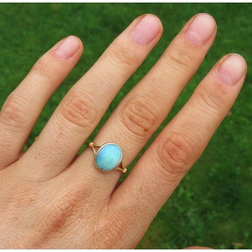 25 - 18ct and very bright blue opal ring size M  3g