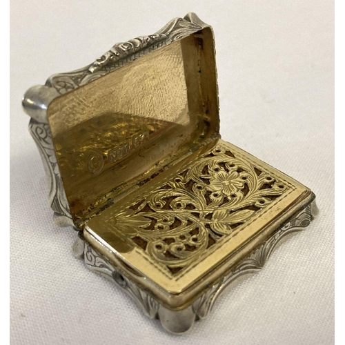 380 - A Victorian silver vinaigrette with silver gilt interior by Nathaniel Mills Birmingham 1843.  Floral...