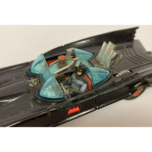 392 - Corgi Toys #267 Batmobile (1st issue), 1966 with red bat logo on gold hubs and no towing hook.  In e...
