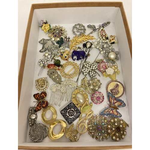 27 - A collection of vintage and modern, brooches, scarf clips and hat pins.  To include stone set, anima...