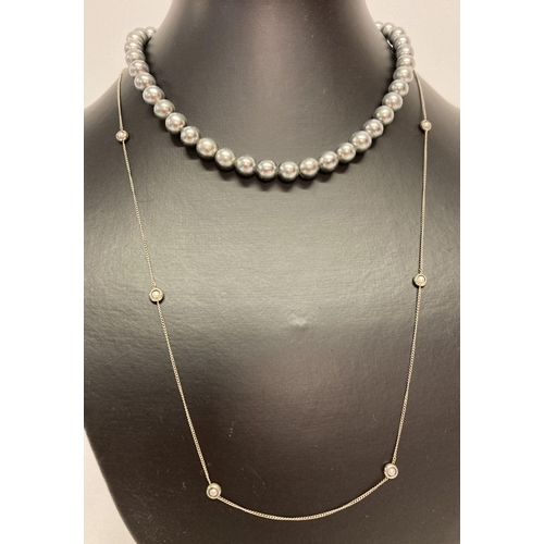 36 - A vintage faux black pearl necklace with period stone set clasp.  Together with a vintage fine curb ...