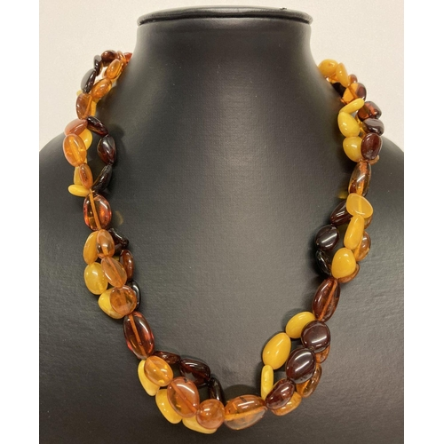 41 - A modern design, tri colour amber bead necklace with silver lobster style clasp and extension chain....