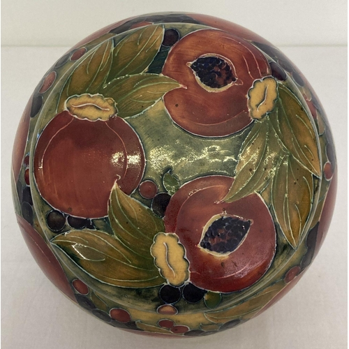 16 - An early 20th century William Moorcroft tobacco jar in Pomegranate design, with screw top cover. Gre...