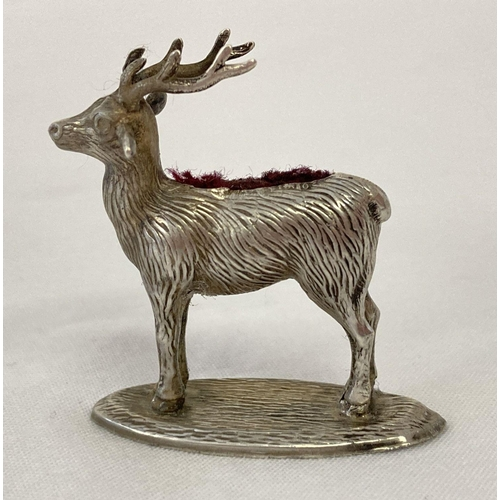 1113 - A novelty silver stag shaped pin cushion with worn red velvet cushion. Lion passant and date mark vi...