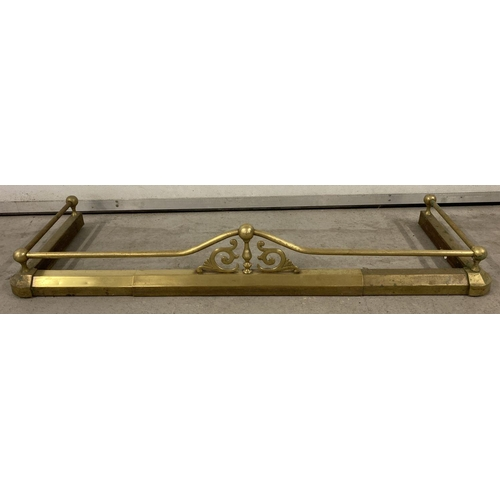 1013 - A vintage extending brass fire fender with finial, rail and scroll detail.