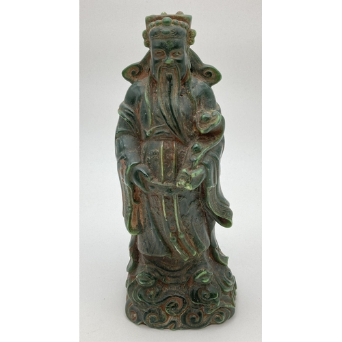1106 - A Chinese carved green jade figurine of an Oriental Deity. Approx. 20cm tall.