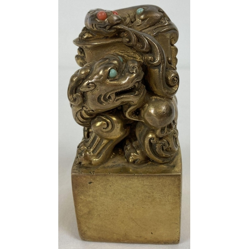 1110 - A Chinese gilt bronze seal with dragon shaped finial and set with turquoise and coral cabochons. App...