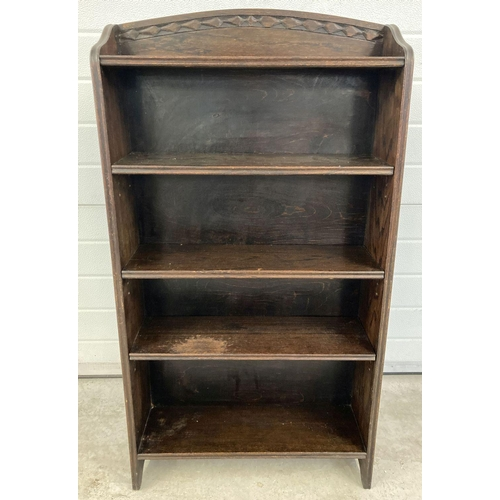 1414 - A vintage dark oak bookcase with adjustable shelves and carved detail to shaped top. Approx. 115 x 6...