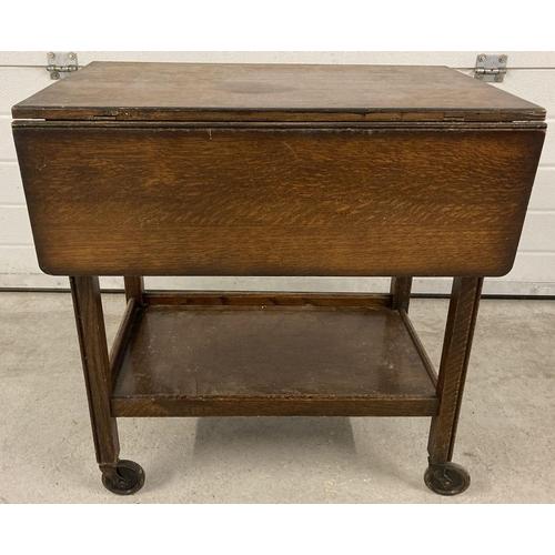1419 - A vintage dark wood drop leaf tea trolley with under shelf. Approx. 69cm tall x 66cm wide.