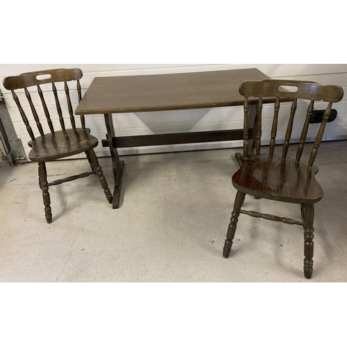 1424 - A dark wood refectory table together with 2 dark wood farmhouse style chairs.