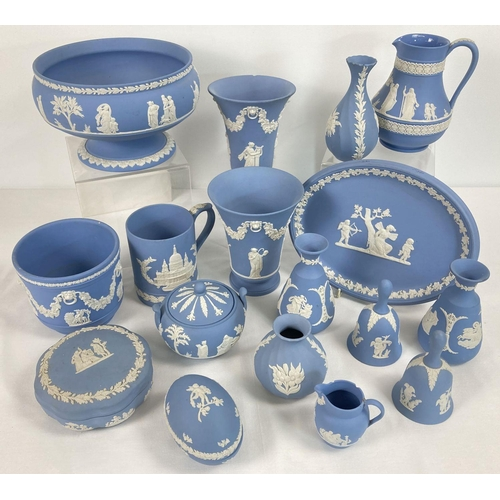 1052 - A collection of 17 items of Wedgwood blue and white jasperware ceramics. To include: pairs of vases,...