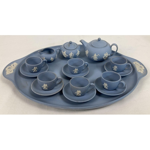 1067 - A Wedgwood blue & white jasper ware miniature 6 setting tea set on a 2 handled tray. Tray approx. 27...