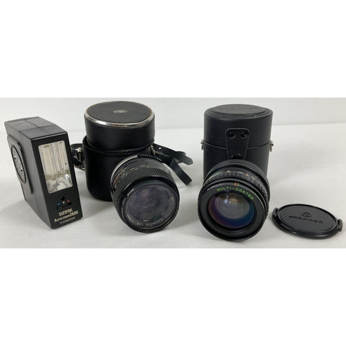 1213 - A cased Chinon 1:28 f=28mm Multi Coated lens together with a cased Makinon Multi Coated 1:28 f=24mm ...