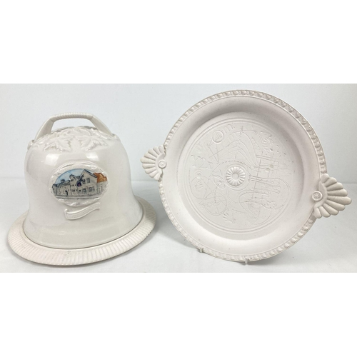1068 - A white ceramic Stilton cheese dome featuring The Bell Inn, Stilton and dated 2005 (a/f). Together w...