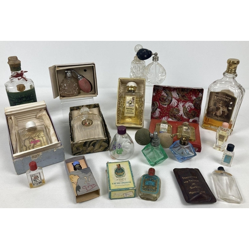 1373 - A collection of vintage perfume bottles, some with contents and original boxes. To include boxed min...