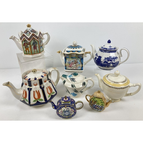 1081 - A collection of assorted vintage ceramic teapots. To include Sadler, Wade Rington's and Gibsons Nevi...