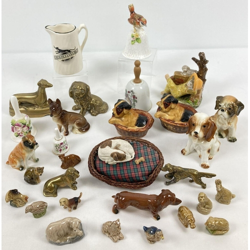 1084 - A collection of ceramic and brass dog figures. Together with Wade Whimsies, ceramic bells and vintag...
