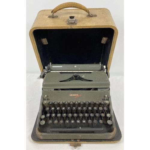 1352 - A dark green finish Hermes 2000 typewriter in hard carry case.