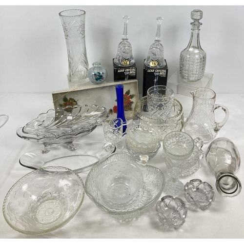 1102 - A large collection of assorted vintage and modern glass ware. To include: boxed crystal bells, decan...
