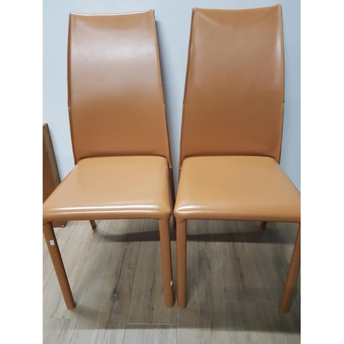 32 - 2 BROWN LEATHERETTE DINING CHAIRS...