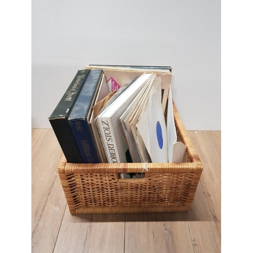 55 - A WICKER BASKET CONTAINING ASSORTED LP RECORDS...