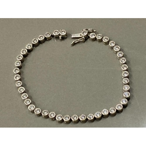 22 - SILVER AND CZ LINE BRACELET 11.7G GROSS...