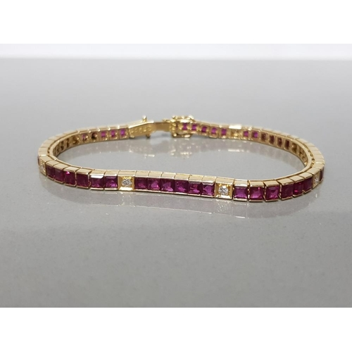 15 - 5CT NATURAL RUBY LINE BRACELET WITH DIAMOND SPACERS SET IN 18CT YELLOW GOLD GROSS WEIGHT 18.5G...