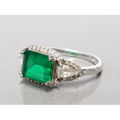 4 - 925 STERLING SILVER GREEN STONE RING WITH 2 CZ PEAR CUT STONES SIZE O GROSS WEIGHT 3.3G...