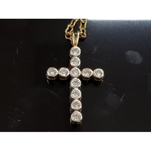 49 - HALLMARKED 9CT GOLD CRUCIFIX WITH INLAID WHITE STONES 4.3 GRAMS GROSS ON A 20 INCH WAISTED CABLE LIN...