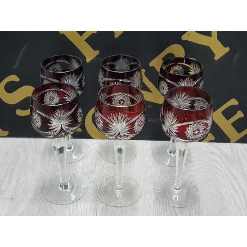 A SET OF 6 BOHEMIAN RUBY CUT DRINKING GLASSES