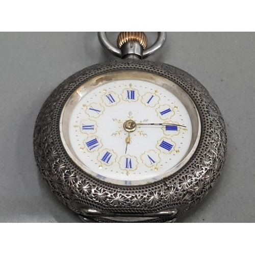9 - LADIES SILVER SMALL POCKET WATCH WITH WHITE DIAL AND BLUE ROMAN NUMERAL HOUR MARKERS WITH GOLD EDGES...