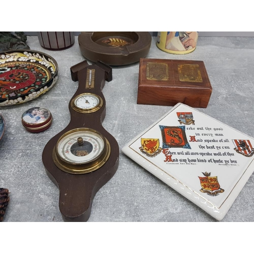 17 - A box of miscellaneous to include studio pottery ashtray barometer with brass dial wooden box with b...