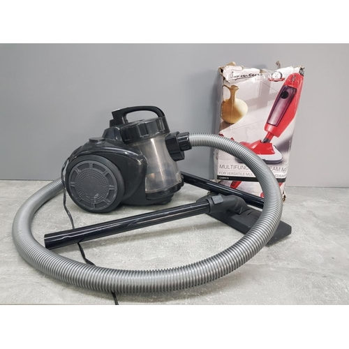 18 - Goblin vacuum together with signature steam cleaner