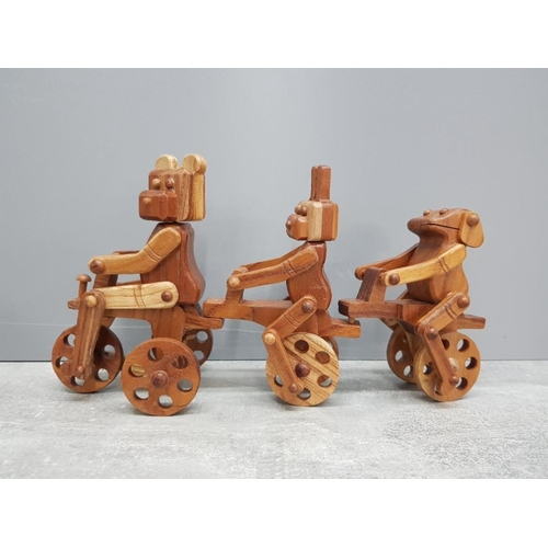 32 - Cycling trio all link together handcarved from hardwood