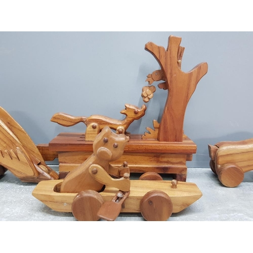 36 - 4 carved hardwood mechanical moving animal toys includes foxb3ith grapes and eagle