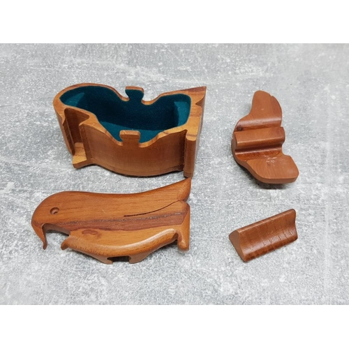 37 - 7 hardwood secret compartment boxes including bull lion rabbit hate frog fish and penguin