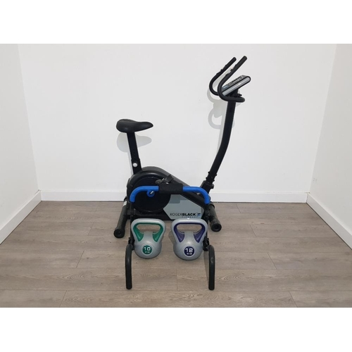 38 - Roger black exercise bike and trainer and 10kg and 12kg kettle bells