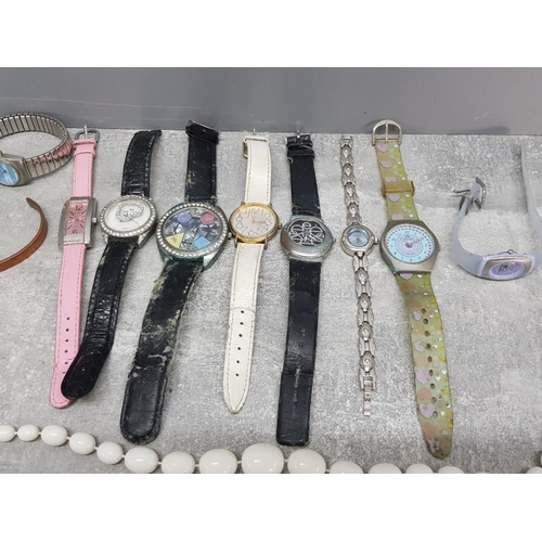 44 - A small tray of costume jewellery includes watches copper bangle etc