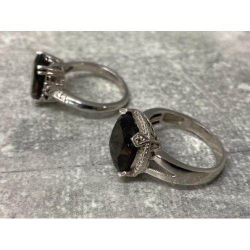 50 - 2 silver plated rings set with Smokey quartz, size r and s, gross 9g